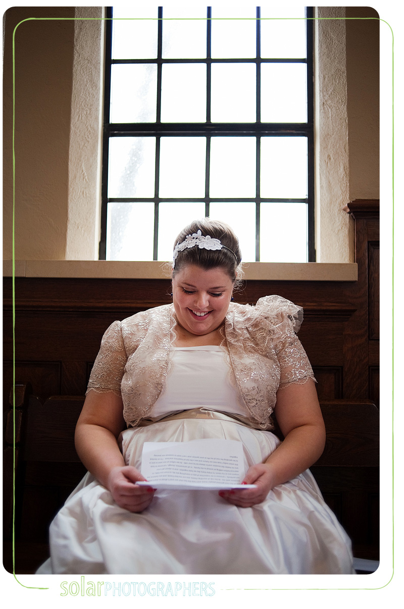 A bride reviews her wedding vows before her ceremony.
