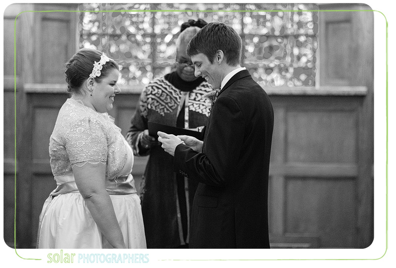 A groom reads his vows to his bride.
