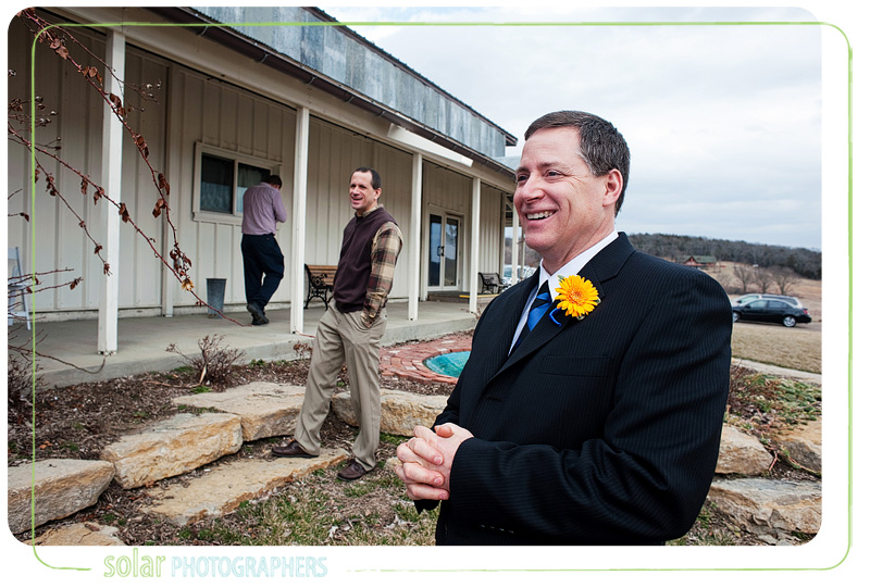 A father of the bride laughing on his daughter's wedding day.