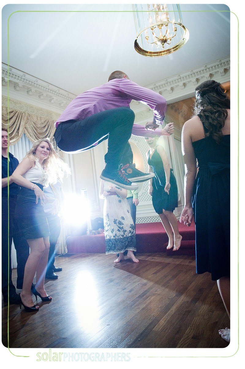 A man jumps at a wedding reception at Loose Mansion in Kansas City, MO.