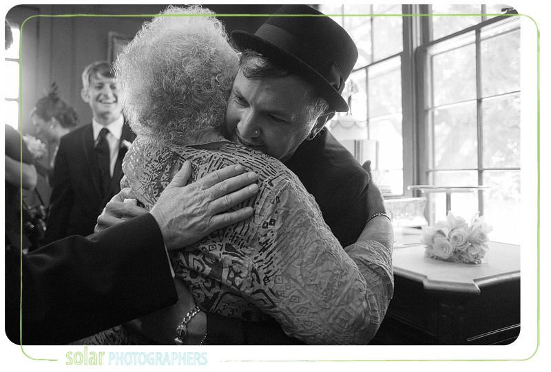 Groom gets emotional while hugging grandma.