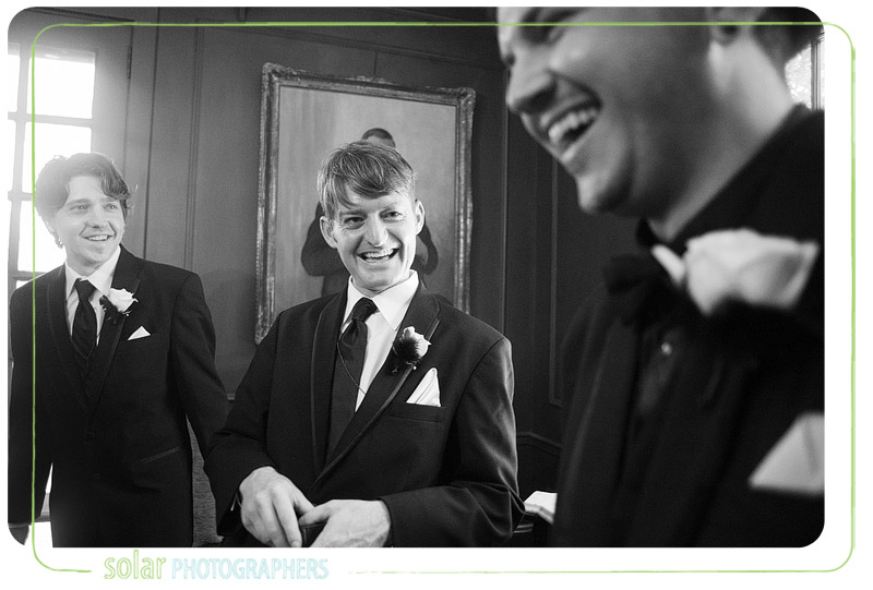 Groom laughing with his groomsmen.