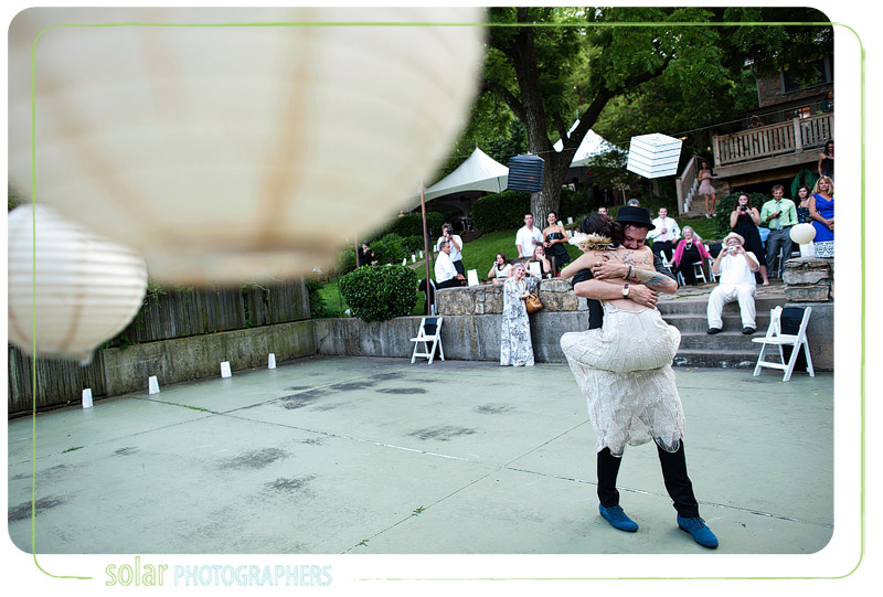 Bride gets emotional during their first dance and jumps into grooms arms.