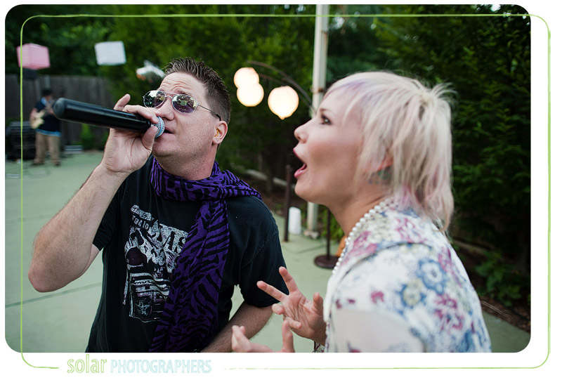 Guest singing with the lead singer of Retroactive at a wedding.