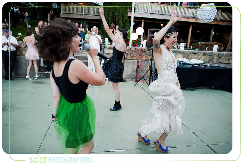 Bride dancing with her sisters.