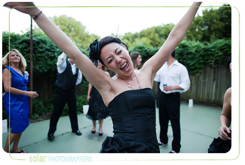 Bridesmaid dancing at a wedding at the Evan Williams House.