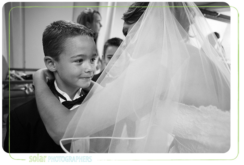 Pretty bride gets her little brother ready for a wedding.