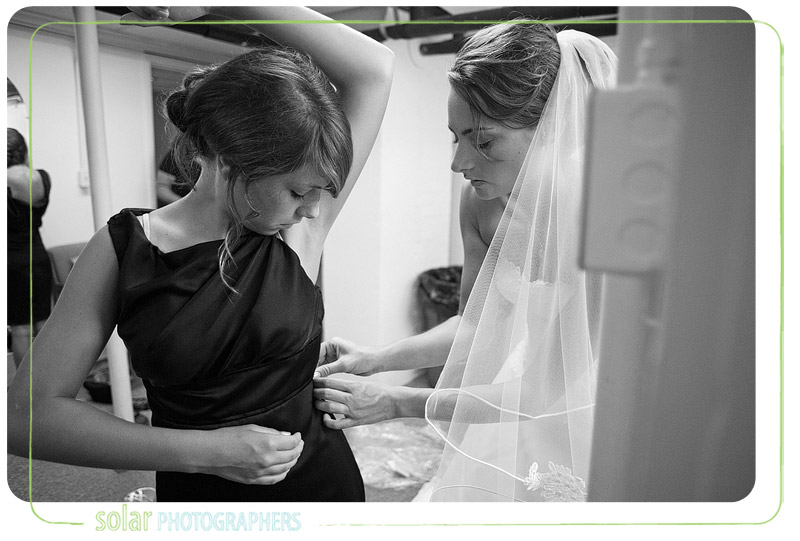 A gorgeous bride helps her little sister get ready for her Kansas City wedding.