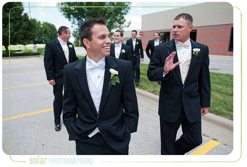 The groom and the best man laughing before his wedding.