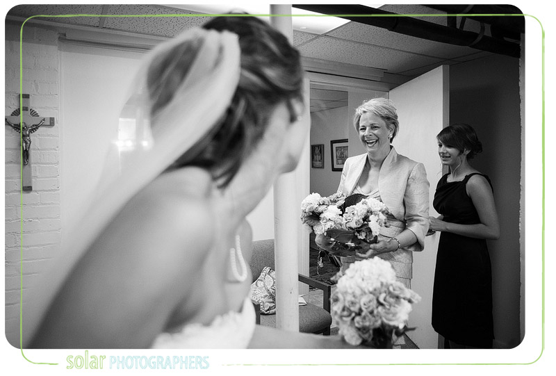 Mother of the bride laughing with her daughter.