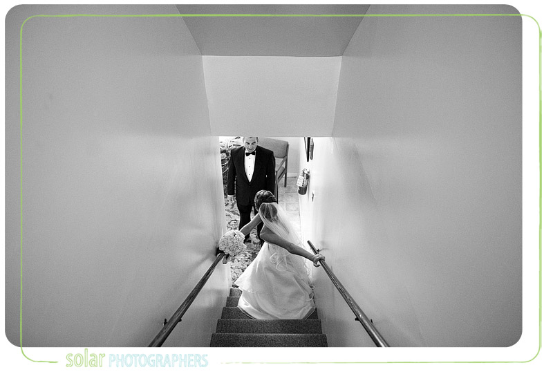 A pretty bride shares an emotional moment with her dad before her Kansas City wedding.