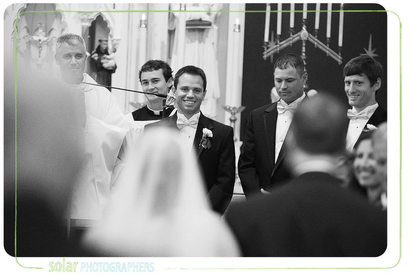 Groom sees his bride for the first time and smiles.