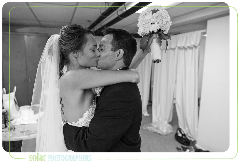 Bride and groom share an emotional moment of love after their wedding.