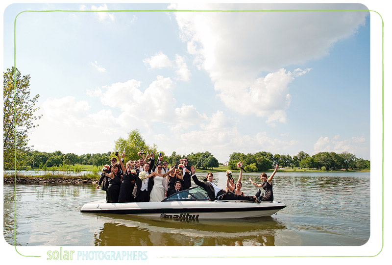 A fun bridal party shot on a boat.