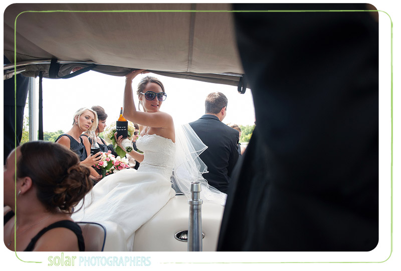 A portrait of a bride on a boat with her friends on her wedding day.