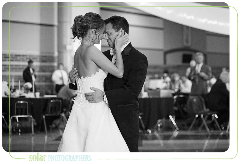 Bride and groom share their first dance at their Kansas City wedding reception.