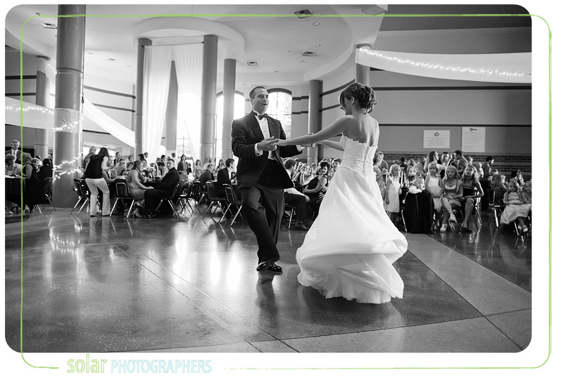 Father of the bride and the bride share an emotional and exciting dance.