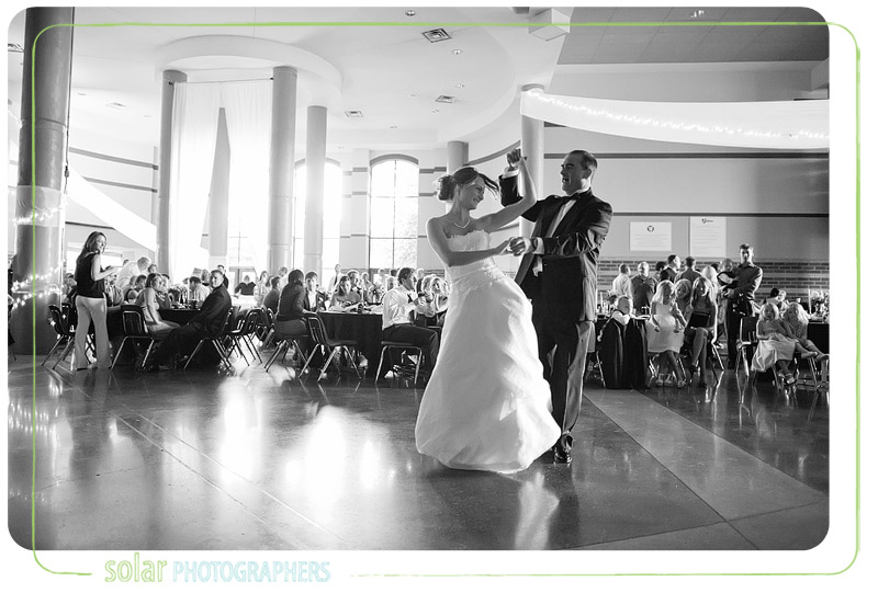 Bride and her father laughing while dancing at their wedding reception.