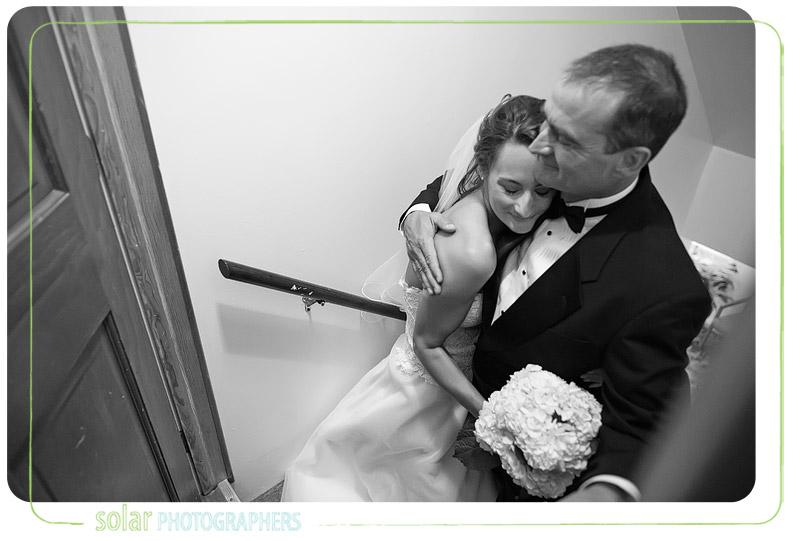 The father of the bride hugs his daughter right before they walk down the aisle together.