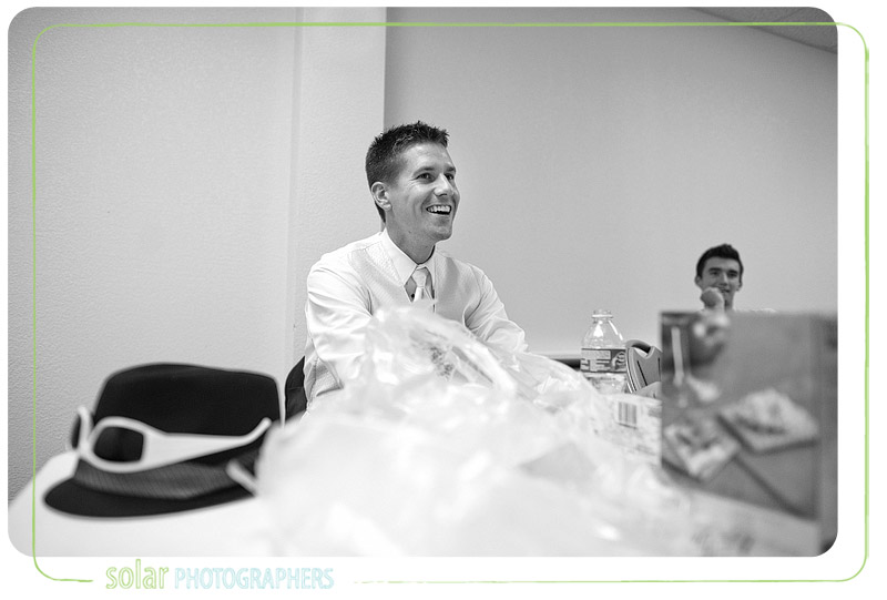 Groom laughing with his friends before his Kansas City wedding.