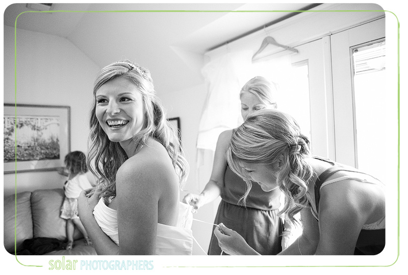 Candid shot of a bride with her bridesmaids getting ready at the Hawthorne House in Kansas City.