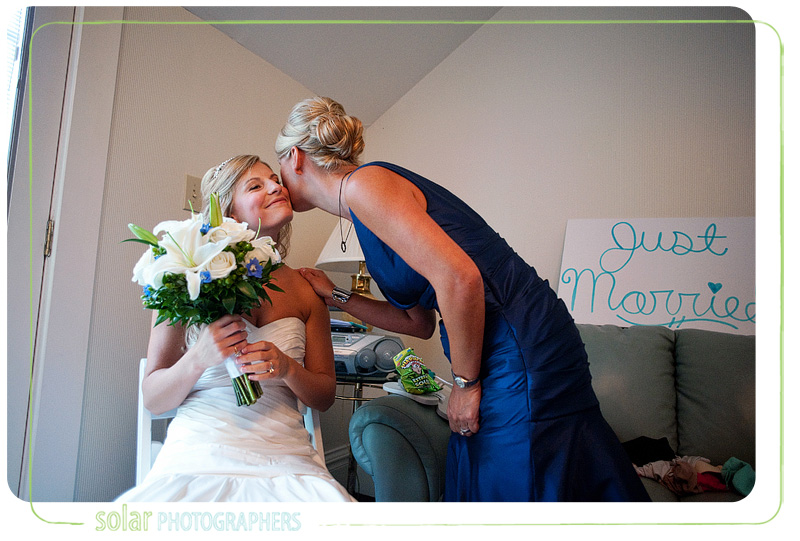 Mother of the bride kisses her daughter before her wedding ceremony.
