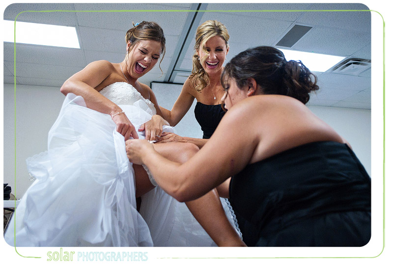 Super excited bride while putting her garter on.