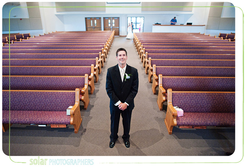 Groom waits for his bride to walk down the aisle for their first meeting.