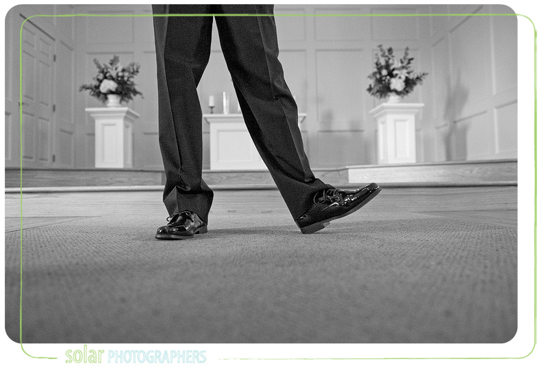 Groom nervously taps his foot.