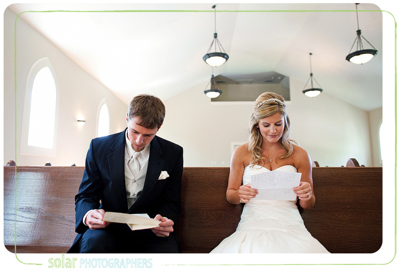 Bride and groom read each other's letters on their wedding day.
