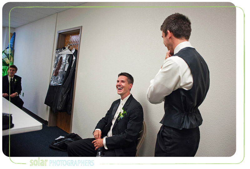 Groom laughs with his friends while waiting for his Kansas City wedding to start.