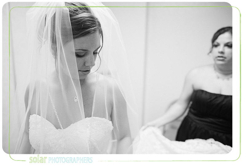 Bride getting ready for her wedding ceremony in Kansas City.