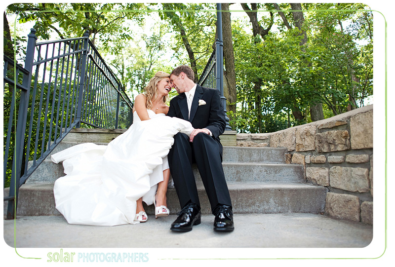Beautiful bride and groom shot as they laugh together at the Hawthorne House in Kansas City.