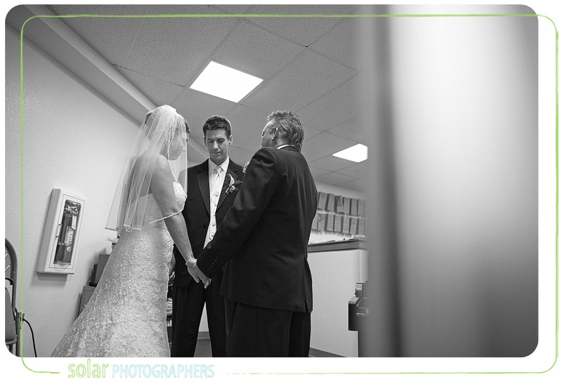 Bride and Groom pray together before their wedding ceremony.