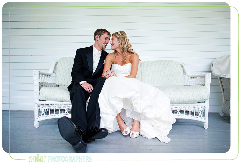 Bride and groom snuggle on a couch together at the Hawthorne House.