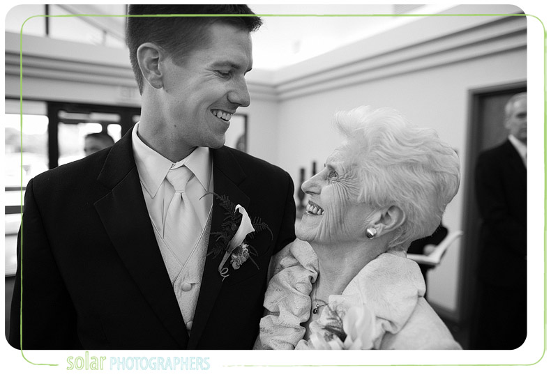 Groom laughs with his grandma before his wedding ceremony.