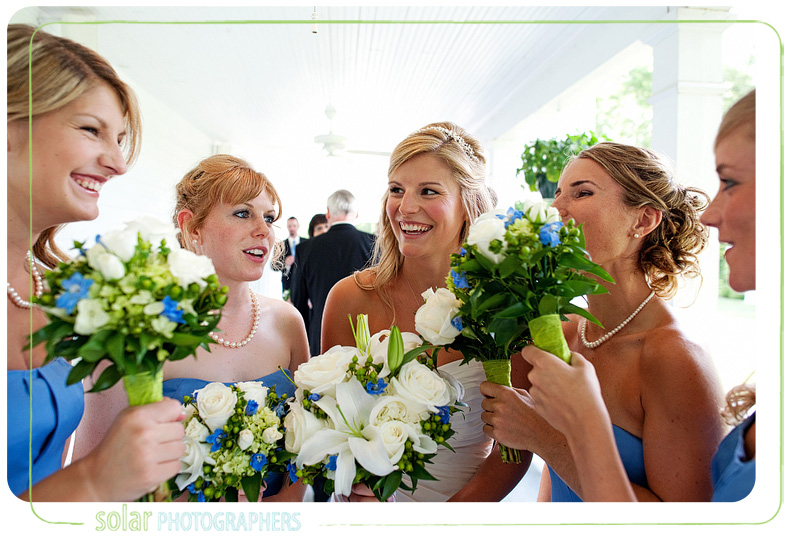 Candid shot of the bride having fun with her bridesmaids on the porch at Hawthorne House.