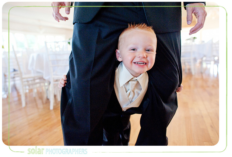 A cut ring bearer plays peek-a-boo with me.