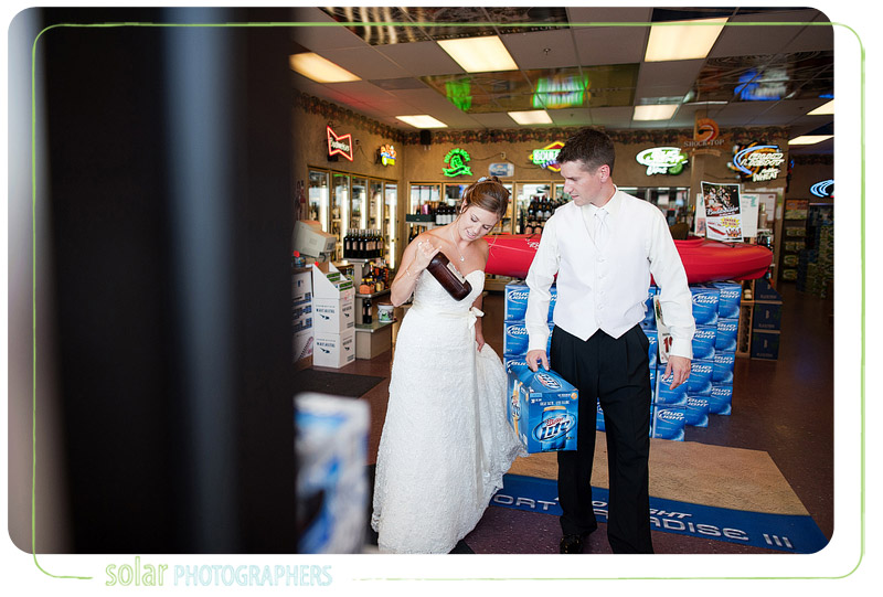 Bride and groom in a liquor store on their wedding day.