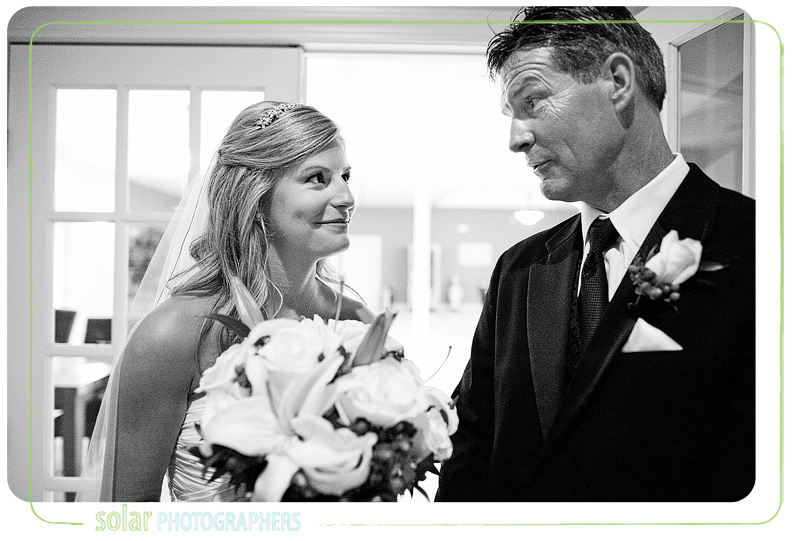 Bride and father share a moment before her wedding begins.