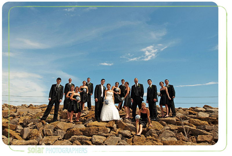 Awesome bridal party portrait on some hot rocks.