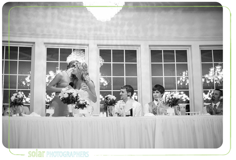 Bride hugs her sister after her Maid of Honor speech during their wedding reception.