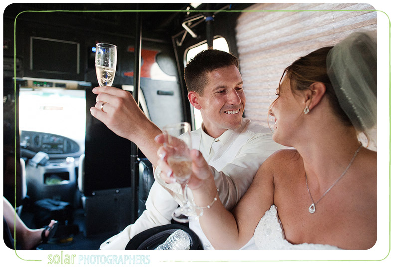 Groom toasts his bride on a party bus.