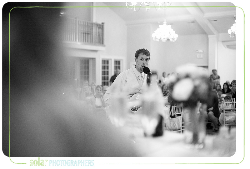 Groom surprises his bride with a song at their wedding reception in Kansas City at the Hawthorne House.