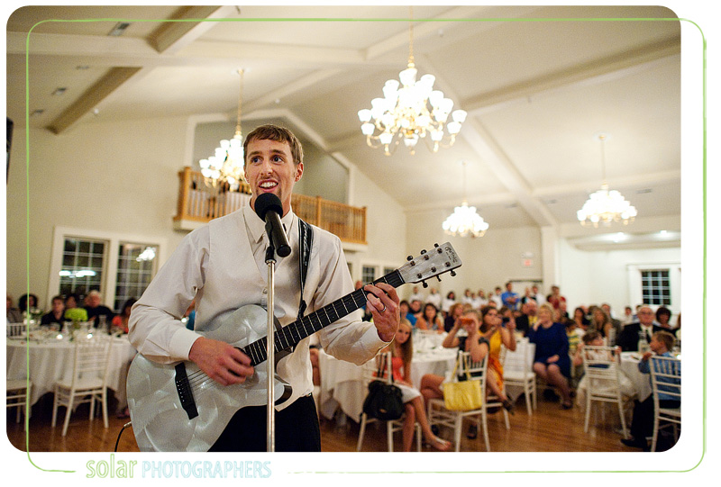 Groom sings to his bride during their wedding reception.