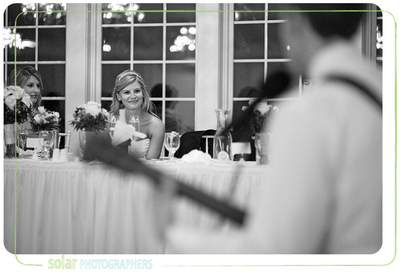 A beautiful moment happens as the bride listens to her husband sing her a song he wrote for her.