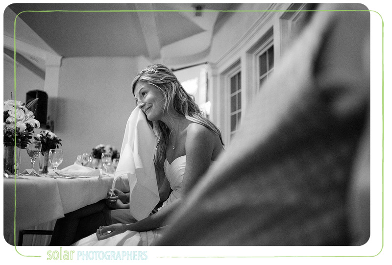 Bride crying as her husband sings to her during their wedding reception.