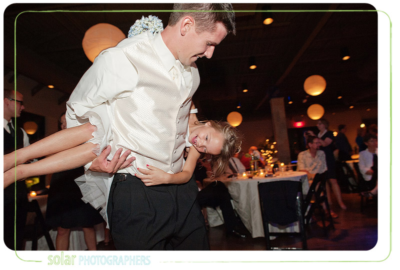 Groom spinning with the flower girl.