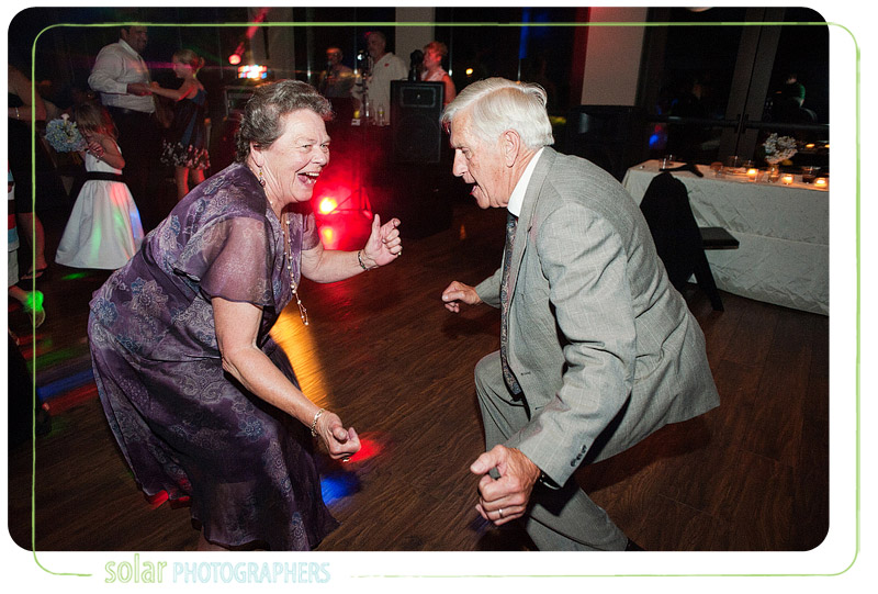 Grandma dancing wildly at a wedding reception.
