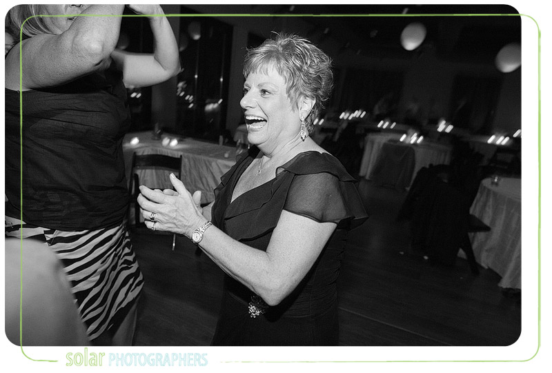 Mom having fun dancing at a wedding reception in Kansas City.